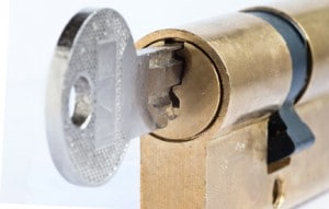 Detail of the key and plug - locked - cylinder lock - under lock and key - sense of security